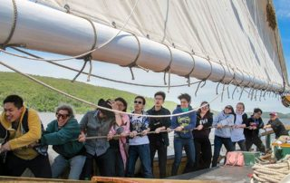 EF Academy students hoist the sails