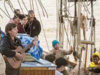 Onboard educators sing in honor of Pete Seeger